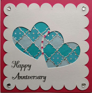 PAT380, Interlinked Hearts, White Scaloped Panel,on Raspberry Square Happy Anniversary Sqr Patchwork Card Kit (144mm x 144mm)